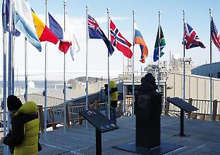 International flags fly at McMurdo Station.