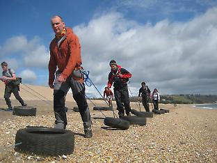 Dragging tyres along one of the south coast beaches, UK.